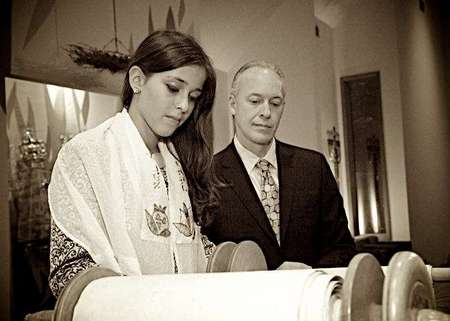 Father and daughter, a twin, at the Torah.