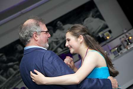 Bat Mitzvah girl dances with her Dad